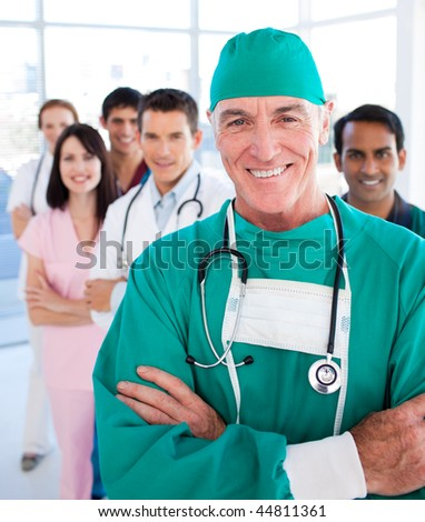 Multi-ethnic medical group smiling at the camera in a hospital