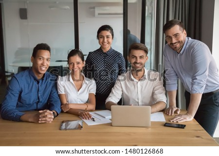 Multi-ethnic millennial employees company members different ethnicity international corporate department photographed in office. Career and leadership, portrait of successful motivated team concept