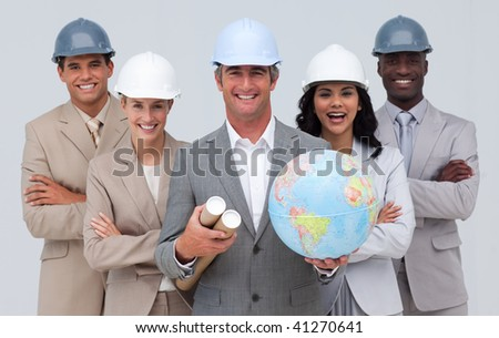 Multi-ethnic smiling enginner team holding a terrestrial globe