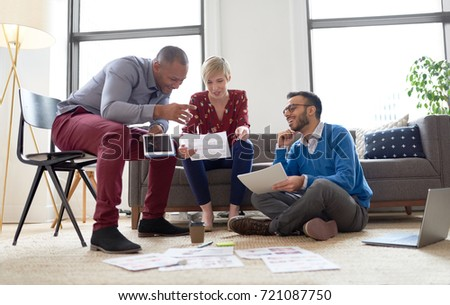 Multi-ethnic team of creative millenials collaborating on a brainstorm project