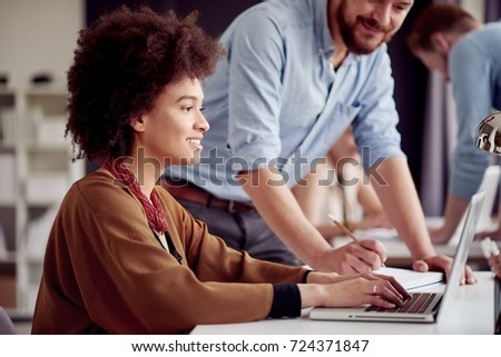 Multi ethnic team working at modern office space #724371847