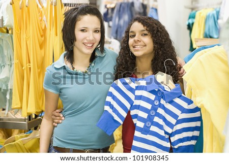 Multi-ethnic teenage girls in clothing store - stock photo