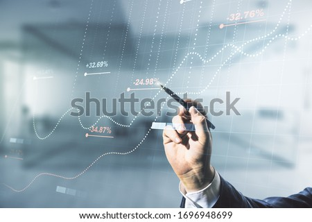 Multi exposure of male hand with pen working with abstract virtual graphic data spreadsheet sketch on blurred office background, analytics and analysis concept