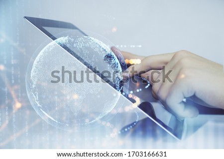 Multi exposure of man's hands holding and using a digital device and map drawing. International business concept.