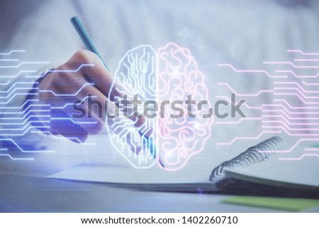 Multi exposure of writing hand on background with brain hologram. Concept of self learning.