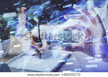Multi exposure of writing hands on background with data solution hologram. Technology concept.
