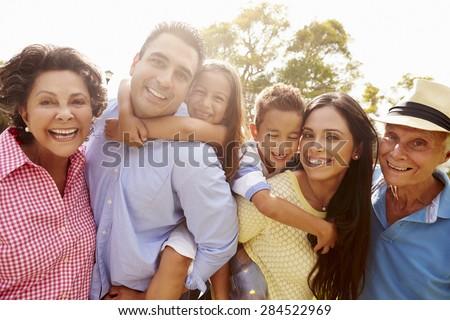 Multi Generation Family Having Fun In Garden Together