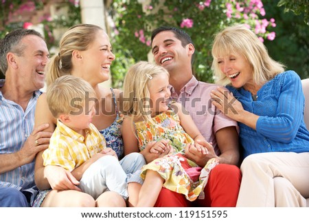 Multi Generation Family Sitting On Sofa Together - stock photo