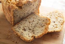 Multi-grain bread made in a home electric bread maker.