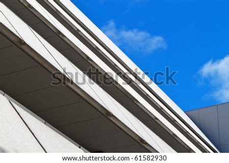 Multi-level angular building against blue sky and clouds #61582930