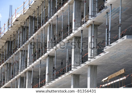 Multi-level commercial high-rise building construction with  blue sky