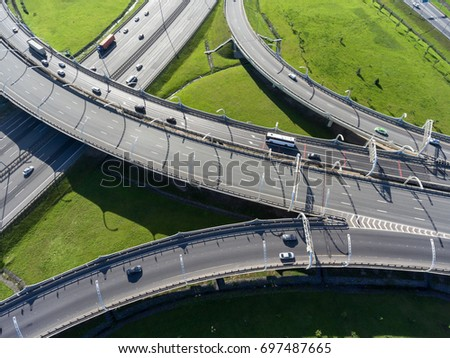 Multi-level interchange of city ringroad with driving vehicles. Aerial view. St. Petersburg, Russia #697487665