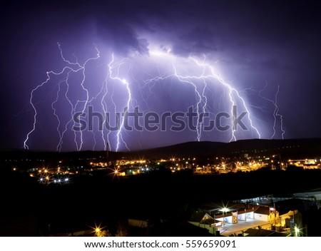 Multi lightening storm flash. Thunderstorm over city.