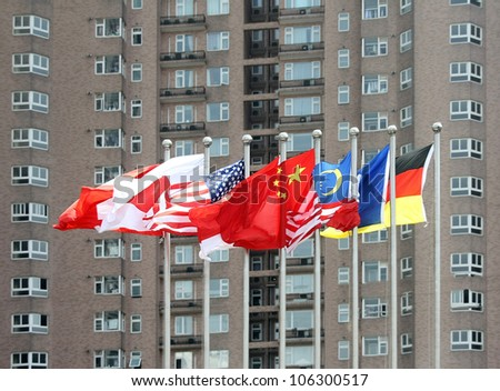 Multi-national flags in front of a high building