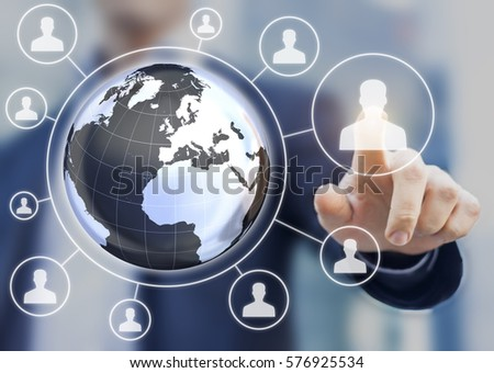 Multi-national human resources (HR) management concept with 3d earth globe map and manager selecting a candidate profile on a virtual screen