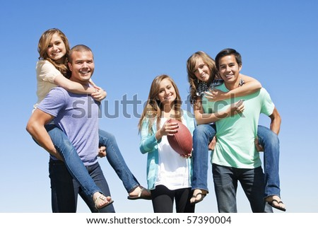 Multi-racial group  of friends Having Fun together