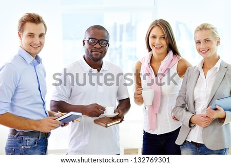 Multi-racial team of four being ready to collaborate