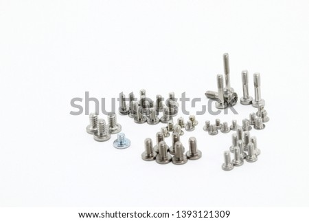 Multi size of small screws, metal screws, iron screws, wood screws isolated on whited background