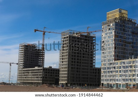 Multi-storey building in the middle of the desert. Industrial background of building construction with a crane Сток-фото ©