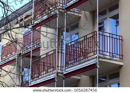 Multi-storey house with windows and balconies / Windows and balconies #1056287456