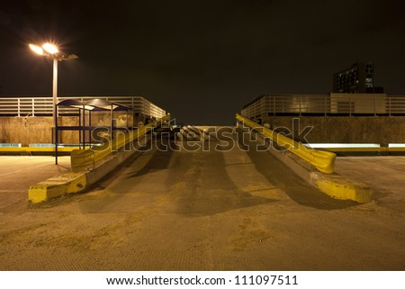 multi story car park rooftop at night empty in england, uk