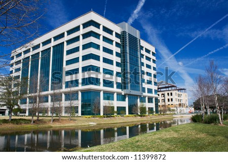 multi-story modern office building along the Riverwalk in Jacksonville, Florida