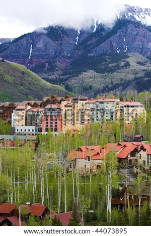 Multi story skiing hotels surrounded by beautiful mountains in Colorado