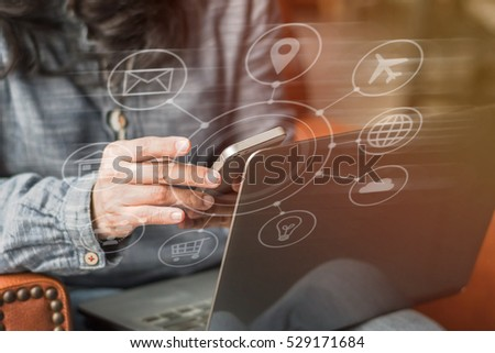 Multichannel online banking payment communication network digital technology via internet wireless application development on mobile smartphone apps: Business woman/ man holding smart phone with icon