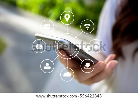 Multichannel online banking payment communication network technology internet wireless application smartphone sync apps: woman holding physical smart phone  icon