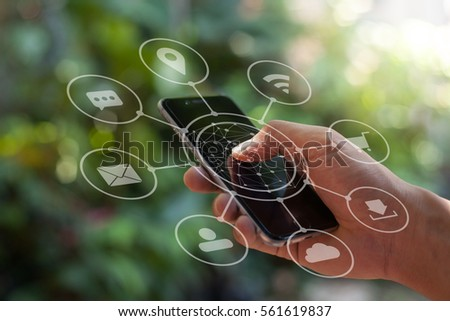 Multichannel online banking payment communication network technology internet wireless application smartphone sync apps: men holding physical smart phone icon