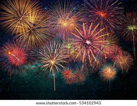 Multicolor Firework Celebration over the soft focus of milky way background #534102943