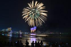 Multicolor fireworks night scene, closeup with pattaya cityscape sea beach view, Thailand.