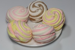 Multicolor  – fruity zephyr. Isolated marshmallow cakes. Closeup of dessert.