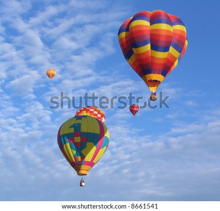Multicolor hot air balloons with blue sky background