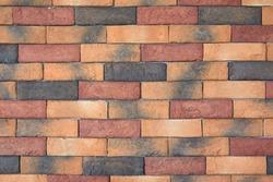 Multicolor new stone brick wall background.