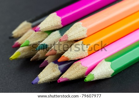 Multicolor pencils close up isolated on black