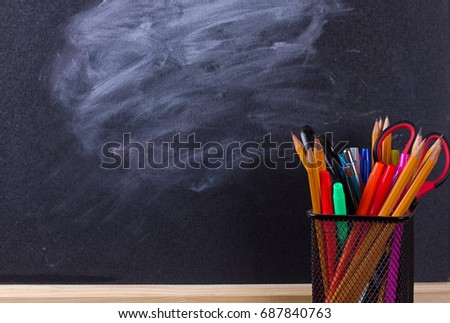 Multicolor pencils with black chalkboard as background. Back to school concept #687840763