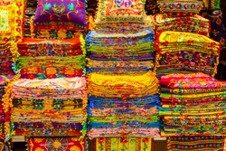 Multicolor pillowcases for sale in the Grand Bazaar Istanbul, Turkey, Kapali Carsi. Arab and Turkish craft products in eastern bazaar.