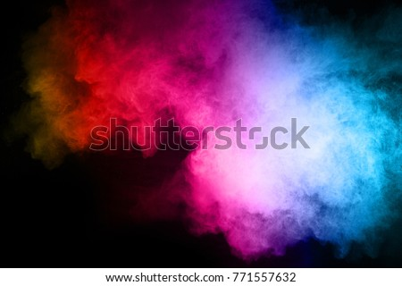 Multicolor powder explosion on black background.  #771557632