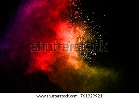 Multicolor powder explosion on black background. Colored cloud. Colorful dust explode. Paint Holi. #761929921