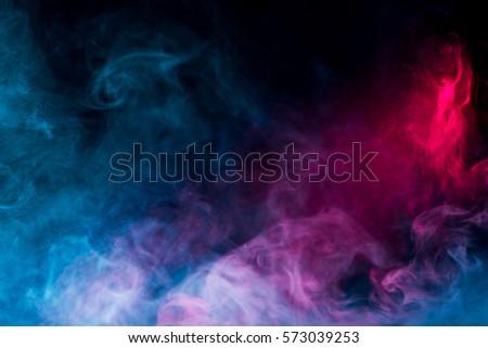 multicolor smoke on black background - Shutterstock ID 573039253