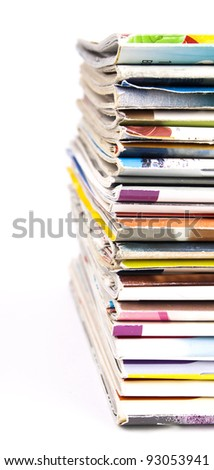 Multicolor stack of magazines isolated on white background