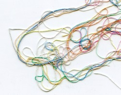 Multicolor tangled color needlecraft silk cord. Abstract color background, in white background