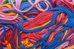 Multicolor threads for backdrop. Chaotic disposition, twisting, villi. Close-up. Color - red, blue, orange, violet, yellow.
