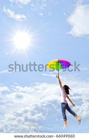 Multicolor umbrella woman against sunlight