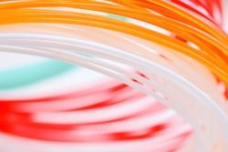 Multicolored ABS/PLN plastic background. Macro shot.