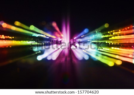Multicolored abstract background of out of focus party lights streaks