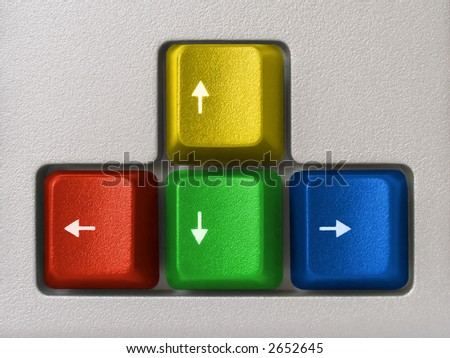 Multicolored arrows (computer keyboard) - red, green, blue, yellow - stock photo