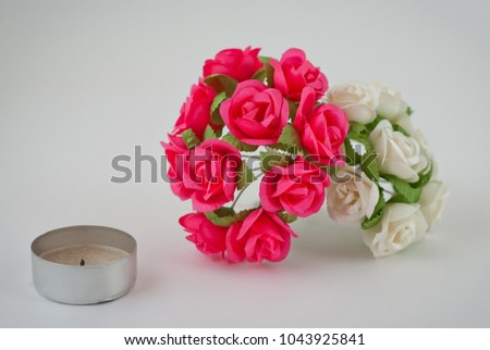 Multicolored artificial flowers on a white background isolated on a multicolored artificial flowers on a white background isolated on a gray background small flowers mightylinksfo