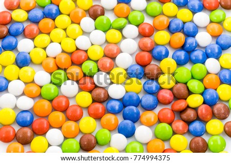 Multicolored background. Bright multicolored background of chocolates. A lot of little pills. #774994375